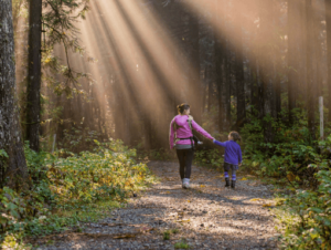 Mother and daughter with autism walking